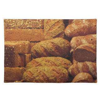 Many mixed breads and rolls background place mat
