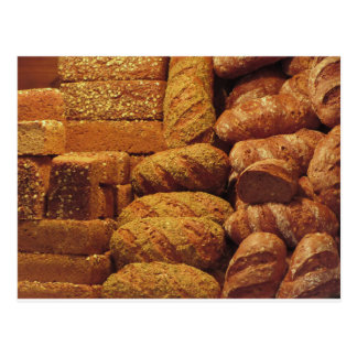 Many mixed breads and rolls background postcard