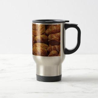 Many mixed breads and rolls background travel mug