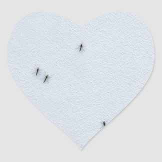 Many mosquitoes on a wall heart sticker