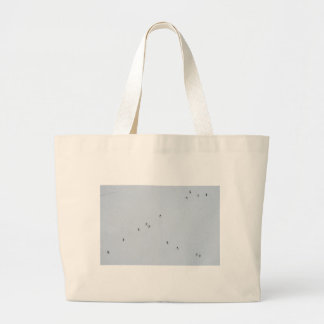 Many mosquitoes on a wall large tote bag