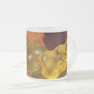 Many multicolored jelly babies... frosted glass coffee mug