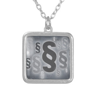 Many paragraphs in front of concrete wall concept silver plated necklace