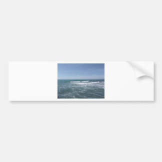 Many people surfing on surfboards in the sea bumper sticker
