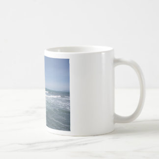Many people surfing on surfboards in the sea coffee mug