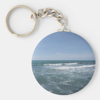 Many people surfing on surfboards in the sea keychain