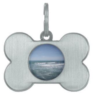 Many people surfing on surfboards in the sea pet ID tags