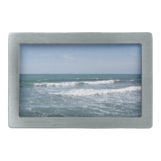 Many people surfing on surfboards in the sea rectangular belt buckles