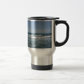 Many people surfing on surfboards in the sea travel mug