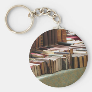 Many second hand books at antique market basic round button keychain