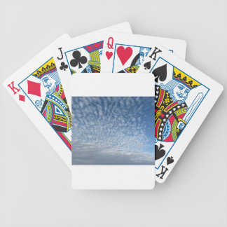 Many soft clouds against blue sky background bicycle playing cards