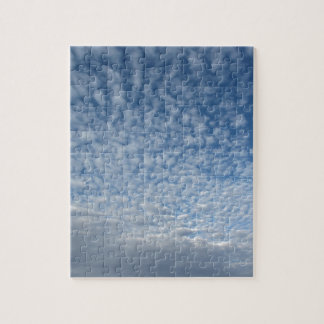 Many soft clouds against blue sky background jigsaw puzzle
