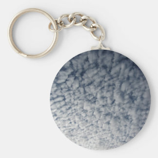 Many soft clouds against blue sky background keychain
