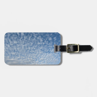 Many soft clouds against blue sky background luggage tag