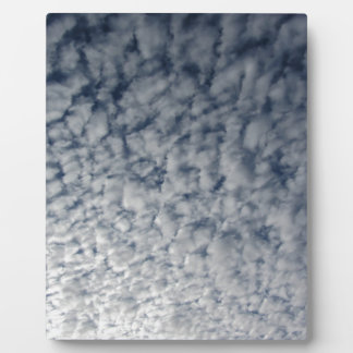 Many soft clouds against blue sky background plaque