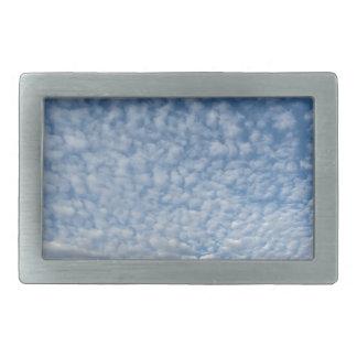 Many soft clouds against blue sky background rectangular belt buckles