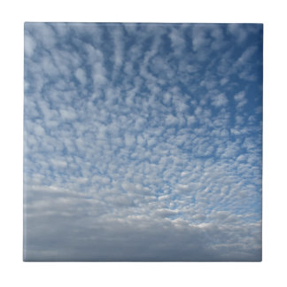 Many soft clouds against blue sky background tile
