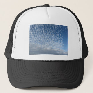 Many soft clouds against blue sky background trucker hat