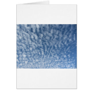 Many soft little clouds against sky background card