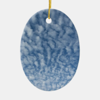 Many soft little clouds against sky background ceramic ornament