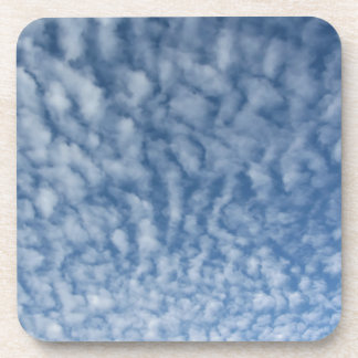 Many soft little clouds against sky background coaster