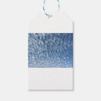 Many soft little clouds against sky background gift tags