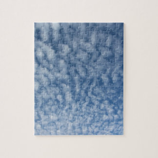 Many soft little clouds against sky background jigsaw puzzle