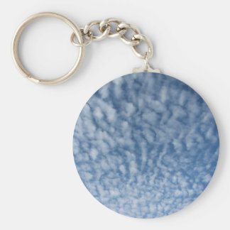 Many soft little clouds against sky background keychain