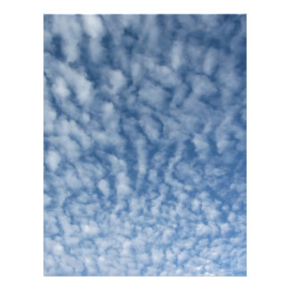 Many soft little clouds against sky background letterhead
