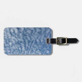 Many soft little clouds against sky background luggage tag