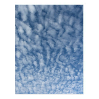 Many soft little clouds against sky background postcard