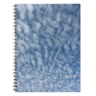 Many soft little clouds against sky background spiral notebook