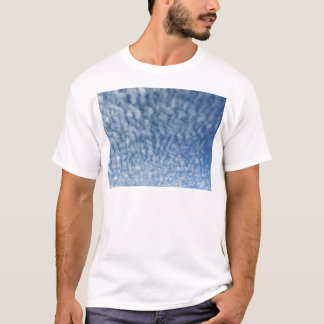 Many soft little clouds against sky background T-Shirt