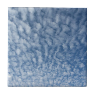 Many soft little clouds against sky background tile