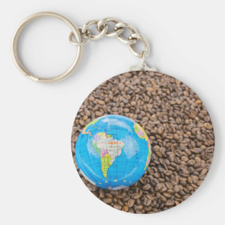 Many whole coffee beans with South America globe Basic Round Button Keychain