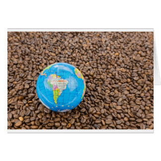 Many whole coffee beans with South America globe Card