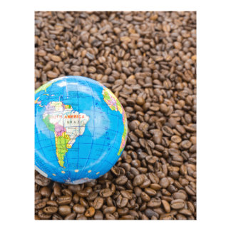 Many whole coffee beans with South America globe Letterhead