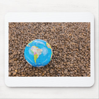 Many whole coffee beans with South America globe Mouse Pad