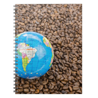 Many whole coffee beans with South America globe Notebook