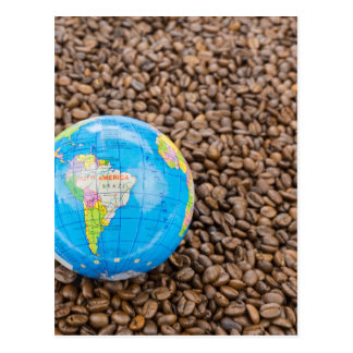Many whole coffee beans with South America globe Postcard