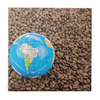 Many whole coffee beans with South America globe Tile