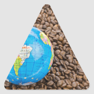 Many whole coffee beans with South America globe Triangle Sticker