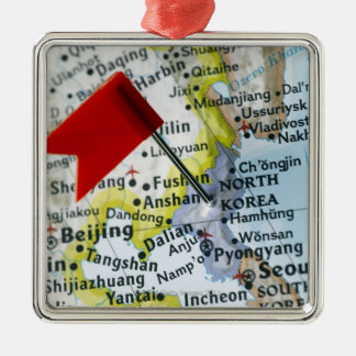 Map pin placed on North Korea on map, close-up Silver-Colored Square Ornament