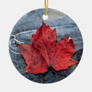 Maple leaf on ice ceramic ornament