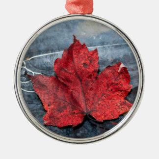 Maple leaf on ice metal ornament