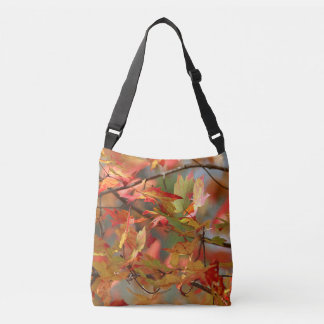 Maple leaves in the wind crossbody bag