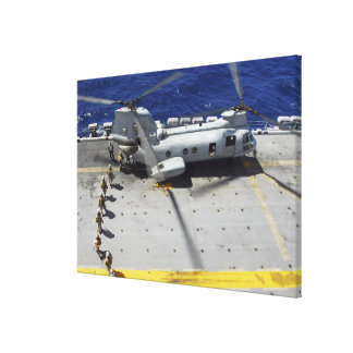 Marines board a CH-46E Sea Knight helicopter Canvas Print