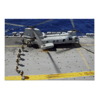 Marines board a CH-46E Sea Knight helicopter Poster