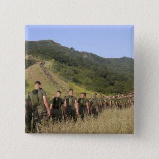 Marines hike their way to a memorial site 2 inch square button