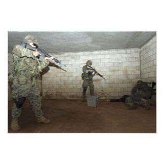 Marines hold an SASO instructor down Photo
